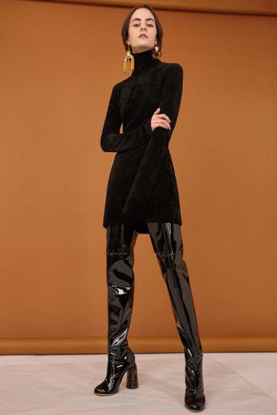 womens-fashion-photography-big-jewelry-tall-boots-turtlenecks-all-black